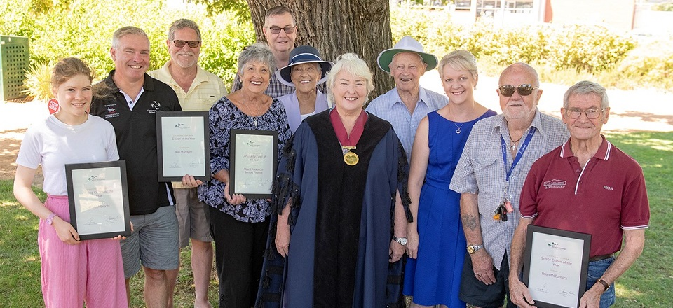 Smiling faces of award winners with Mayor Machin and MP Maree Edwards.