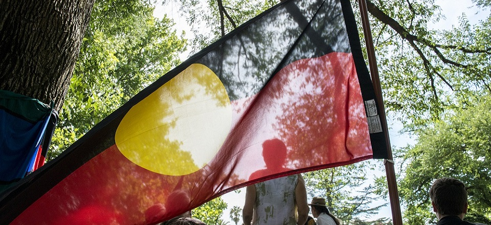 Aboriginal flag on display at Australia Day community event.