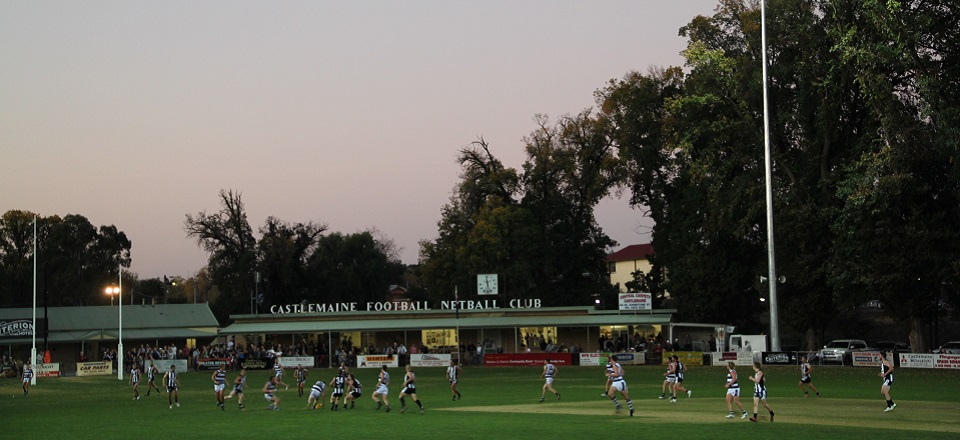 A football match under lights at Camp Reserve in Castlemaine