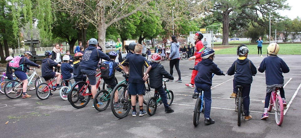 Students line up with their bikes at the Walk to School event.