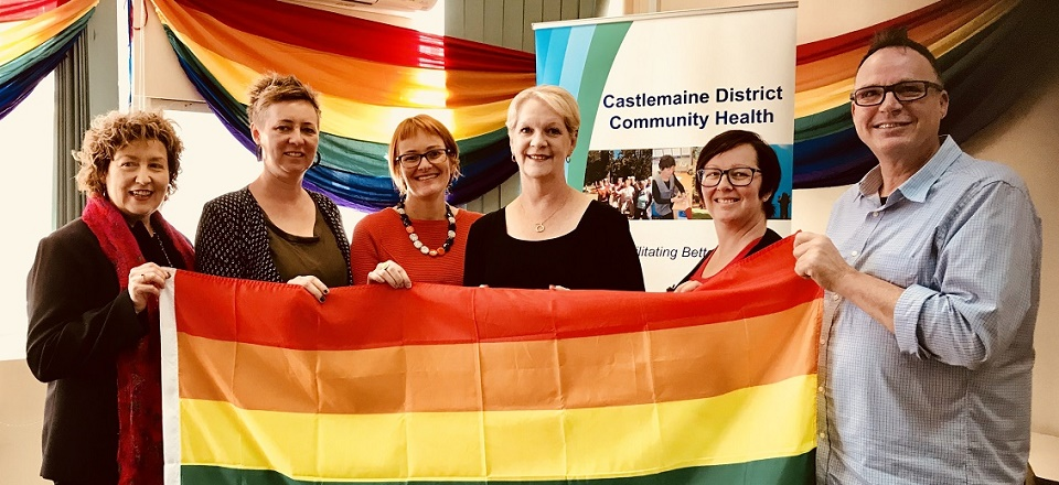 Local community representatives with rainbow flag