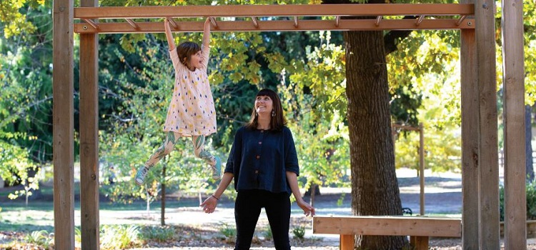 Lady with child in a playground