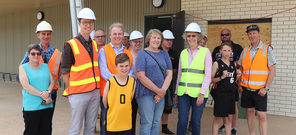 Committee members, Councillors and staff in front of new pavilion.