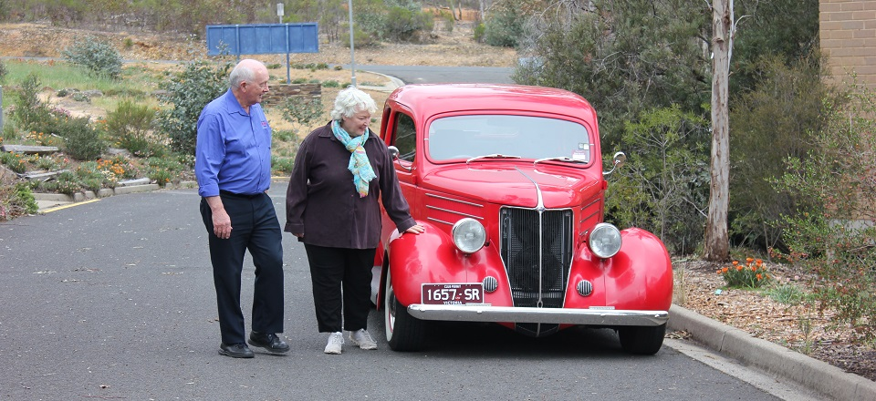 Larry O'Toole and Mayor Machin look at Larry's red hot rod 1936 Ford.
