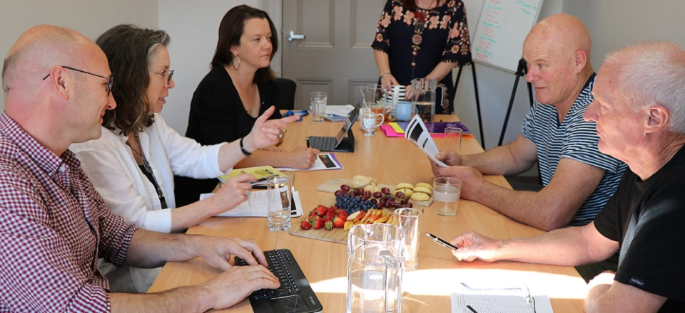 An independent judging panel sit around the table to discuss and deliberate the finalists for the 2019 Mount Alexander Business Awards