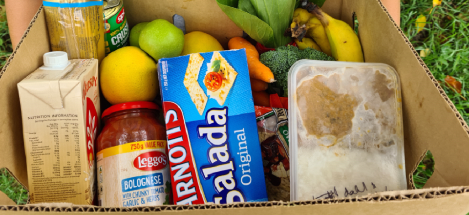Box of groceries and a prepared meal from Mount Alexander Shire Food Pantry food relief program