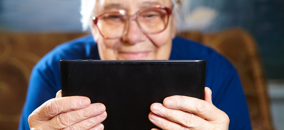 Senior lady holding a tablet device.