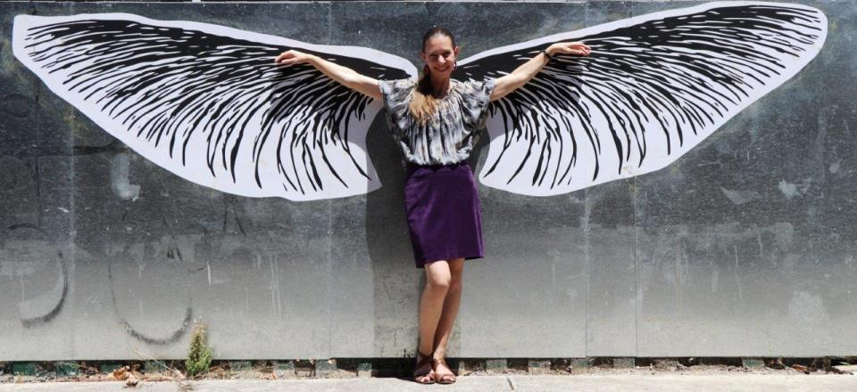 Mount Alexander Shire Council's Cultural Development Officer Vicki Anderson and artwork titled Wings by artist Steve Parsons in Mechanics Lane Castlemaine