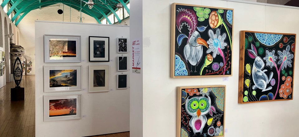 Colourful artworks on display in Market Building.
