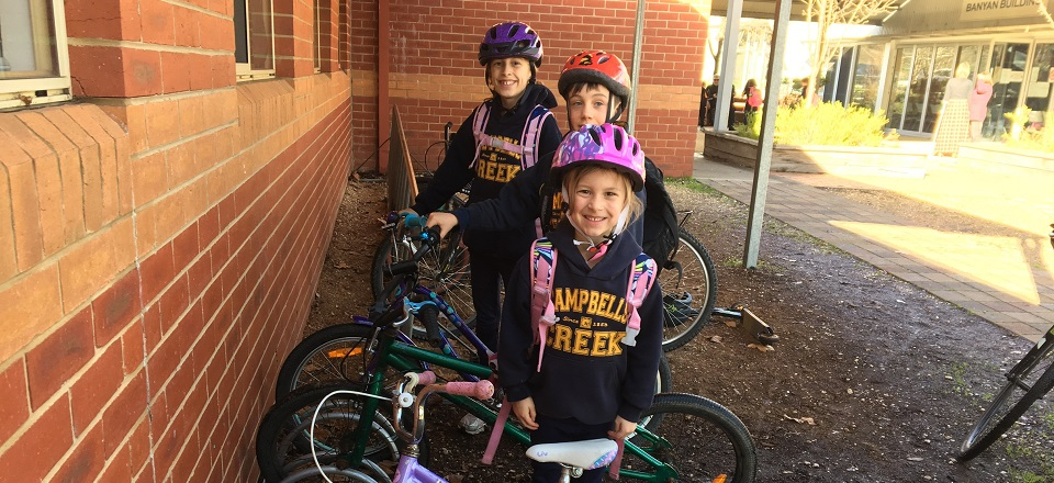 Campbells Creek students with their helmets and bikes.