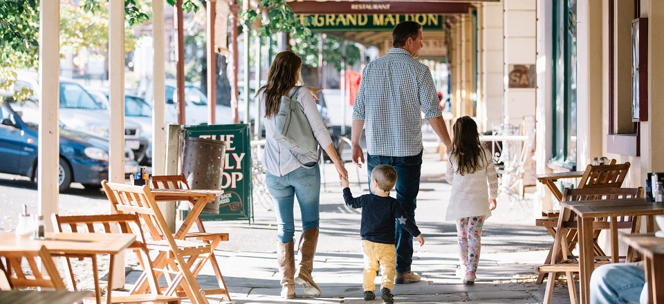 Family walking down historic street in Maldon.