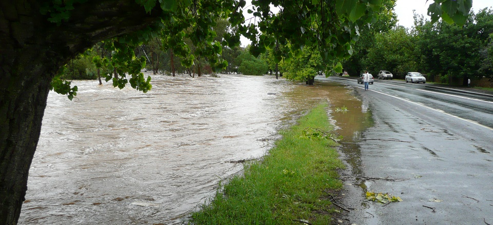 Flooded creek with water over the road