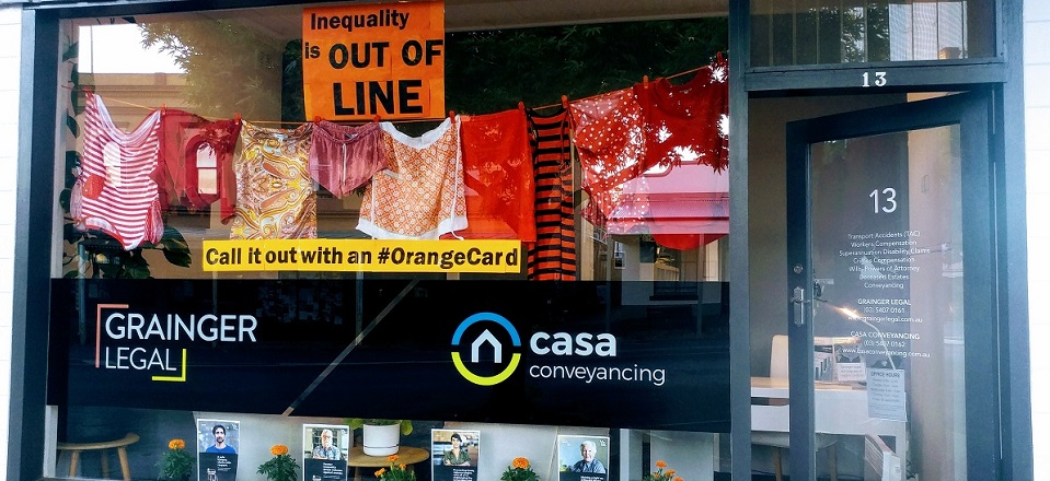 Grainger Legal shopfront decked out in orange in support of gender equality.
