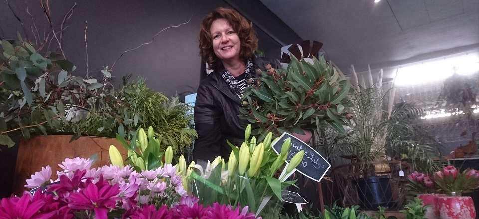 Lynne Jolly surrounded by flowers at Castlemaine Floristry.
