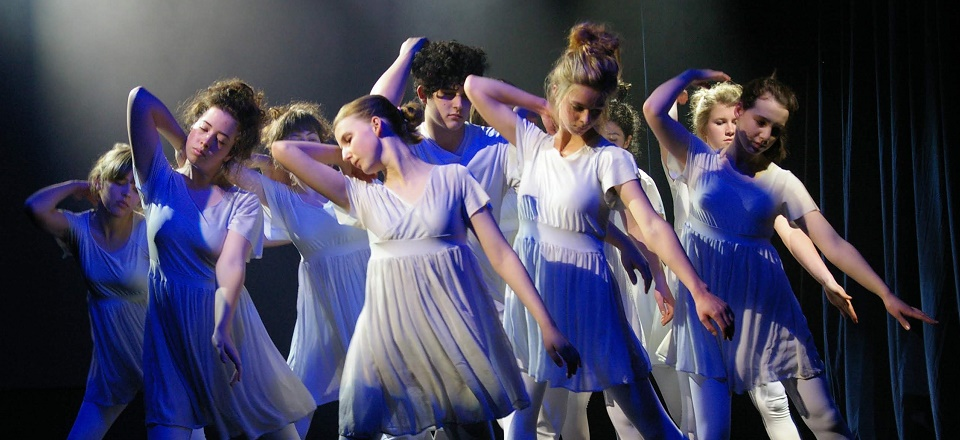 Young dancers move in sync on stage.