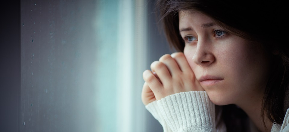 Image: Sad girl sitting at window.  Link to child page: Family violence and staying safe