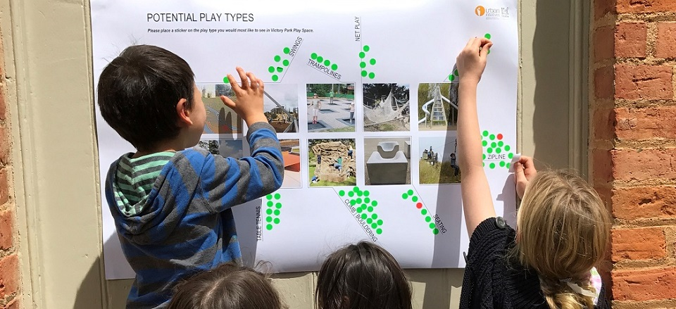 Kids selecting elements they would like to see at play space.